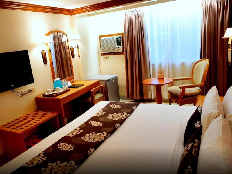 パームガーデンホテル 室内写真 ダブルベッド